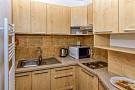 Kuchynka sa nachádza v oboch apartmánoch.